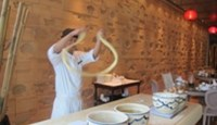 A pull noodles performance at Yuchu restaurant, Intercontinental Asiana Saigon hotel Photo: To Van Nga