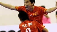Vietnamese players celebrate beating the world champions Brazil to finish third at the International Futsal Cup in Ho Chi Minh City on Friday. Photo by Doc Lap