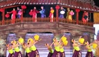 A traditional dance performance in front of the renowned Japanese-style bridge in Hoi An