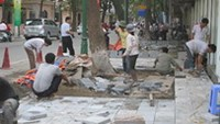 Trang Tri sidewalk in Hanoi being paved after cables along the street were moved underground.