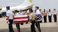 US soldiers carry a casket containing human remains believed to belong to a US serviceman listed as missing in action during the Vietnam War, during a repatriation ceremony at Da Nang International Ai