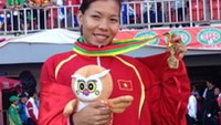 Southeast Asian sprinting queen Vu Thi Huong took the gold medal at the women's 100m race at the 27th SEA Games 2013 in Myanmar on Tuesday. Photo by Quynh Anh