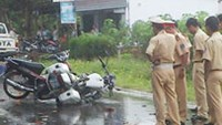 The girls' motorbike and police at the accident scene