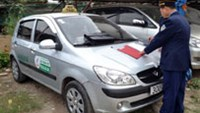 A cab belonging to the Trung Viet Taxi Company. A company representative has told the press that the company will sack the driver accused of fleecing an Australian couple if the allegations are proven