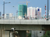 Two workers at a bridge construction site in Ho Chi Minh City.