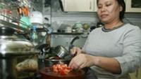 A maid works in a foreigner's house in Ho Chi Minh City.