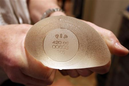 Plastic surgeon Denis Boucq displays a silicone gel breast implant manufactured by French company Poly Implant Prothese (PIP) in a clinic in Nice December 26, 2011.