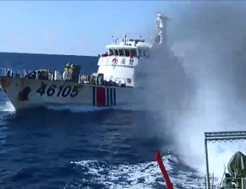 This video grab image taken on June 1, 2014 from Vietnam Coast Guard ship 2016 and released on June 5, 2014 shows the Chinese Coast Guard ship 46001 (L) chasing a Vietnamese vessel near to the site of the Chinese oil rig in the disputed waters in the East