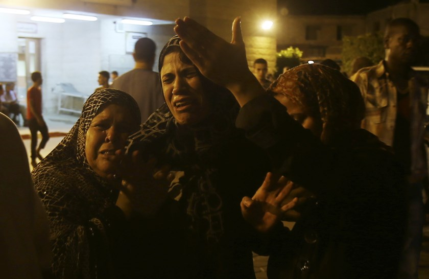 Women mourn after an Israeli air strike killed two Palestinian militants, at a hospital morgue in the central Gaza Strip July 6, 2014. Photo credit: Reuters