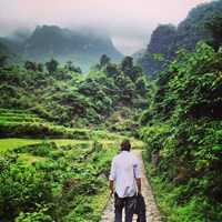 The author walking the hills in Pac Bo, site of a cave where Ho Chi Minh famously hid in 1941. Photo: Olof