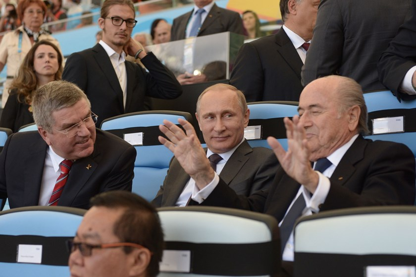 (From L) IOC chief Thomas Bach, Russia's President Vladimir Putin and FIFA President Joseph Blatter attend the 2014 FIFA World Cup final football match between Germany and Argentina at the Maracana Stadium on July 13. Photo credit:AFP