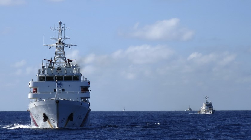 Chinese coastguard ships give chase to Vietnamese coastguard vessels (not pictured) after they came within 10 nautical miles of the Haiyang Shiyou 981, known in Vietnam as HD-981, oil rig in the East Sea, July 15, 2014. Photo credit: Reuters