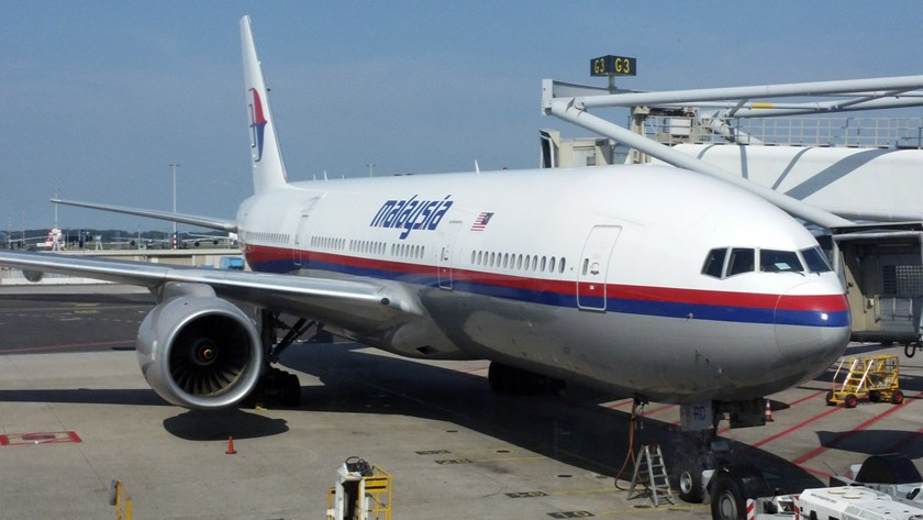 Malaysia Airlines Boeing 777-200ER with registration 9M-MRD operating as flight MH17 is seen at the G3 gate of Schiphol Airport in Amsterdam, before it took off, heading to Kuala Lumpur, July 17, 2014. Photo credit: Reuters