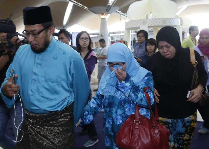 Relatives of passengers onboard the downed Malaysia Airlines flight MH-17 arrive at Kuala Lumpur International Airport in Sepang July 18, 2014. Photo credit: Reuters