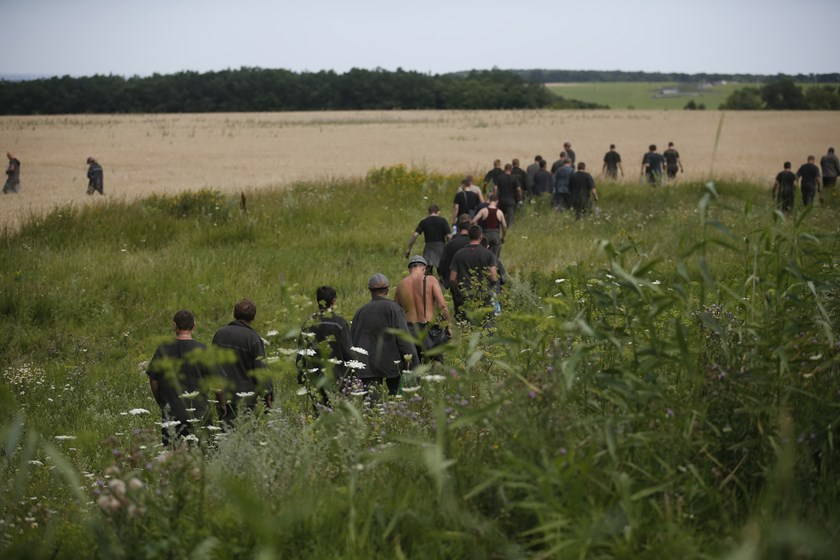 Ukrainian coal miners search the crash site of Malaysia Airlines Flight MH17, near the village of Hrabove, Donetsk region, July 20, 2014. Photo credit: Reuters