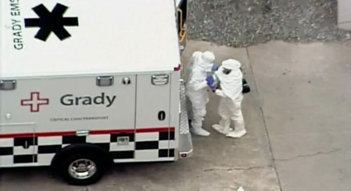 Two men in protective clothing exit an ambulance outside of Emory University hospital prior to entering the hospital in Atlanta, Georgia August 2, 2014 in this still image from video courtesy 11 Alive Atlanta. Photo credit: Reuters