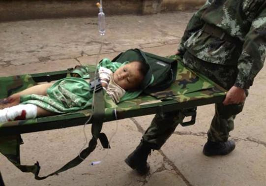 An injured child is carried by paramilitary policemen on a stretcher after an earthquake hit Longtoushan township of Ludian county, Yunnan province August 3, 2014. Photo credit: Reuters