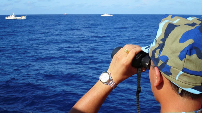 A crewman from the Vietnamese coastguard ship 8003 looks out at sea as Chinese coastguard vessels give chase to Vietnamese ships that came close to the Haiyang Shiyou 981 oil rig in the East Sea, July 15, 2014. Photo credit: Reuters