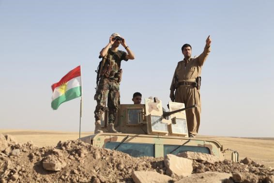 Kurdish peshmerga troops participate in an intensive security deployment against Islamic State militants on the front line in Khazer August 8, 2014. Photo credit: Reuters
