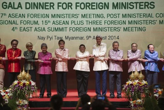 Foreign ministers join hands for a photo during the Association of Southeast Asian Nations (ASEAN) gala dinner at the Myanmar International Convention Center (MICC) in Naypyidaw on August 9, 2014. Photo credit: Reuters