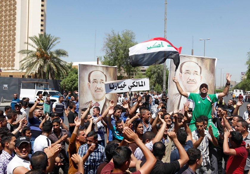 People with portraits of Iraqi Prime Minister Nuri al-Maliki gather at a rally in support of him in Baghdad August 11, 2014. Photo: Reuters