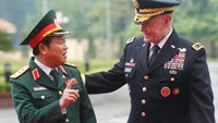 US Chairman of the Joint Chiefs of Staff General Martin Dempsey (R) chats with his Vietnamese counterpart General Do Ba Ty upon his arrival at Vietnam's Defence Ministry in Hanoi August 14, 2014. Photo credit: Reuters