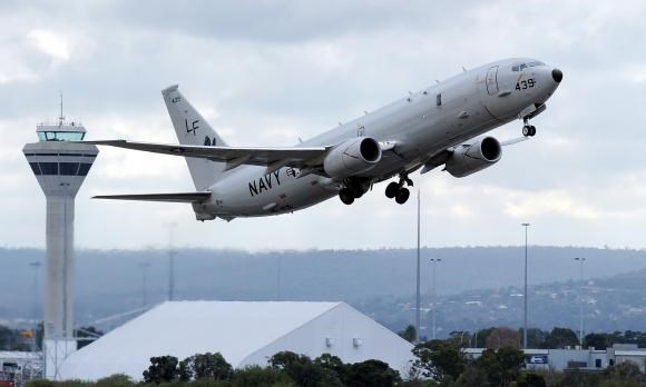 A U.S. Navy P-8 Poseidon aircraft takes off from Perth International Airport in this April 16, 2014 file photo. Photo credit: Reuters