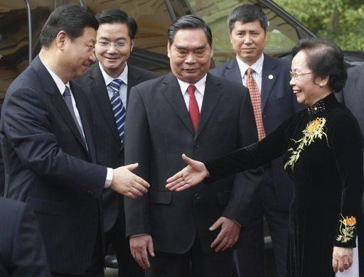 China's then Vice President Xi Jinping (L) is greeted by Vietnam's Vice President Nguyen Thi Doan (R) and Communist Party's Senior Politburo member Le Hong Anh (C) upon his arrival in Hanoi in 2011. Photo credit: Reuters