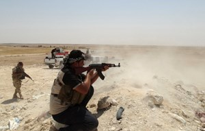 A tribal fighter aims his weapon during an intensive security deployment to fight against militants of the Islamic State, formerly known as the Islamic State of Iraq and the Levant (ISIL), in the town of Haditha, northwest of Baghdad August 25, 2014. Phot