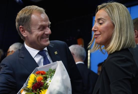 Newly elected European Council President Donald Tusk (L) and newly elected European High Representative for Foreign Affairs Minister Federica Mogherini talk together during a EU summit in Brussels August 30, 2014. Photo credit: Reuters