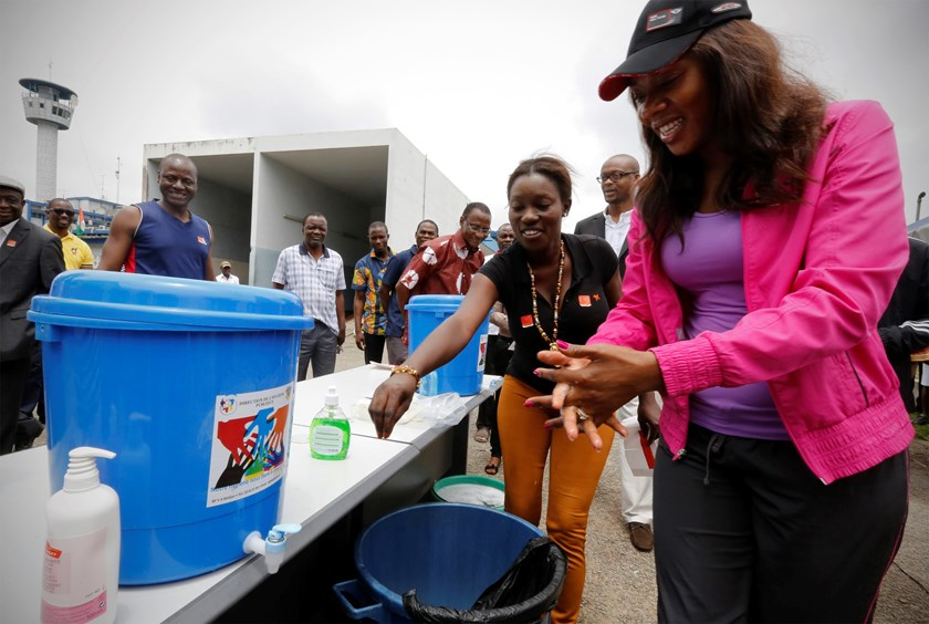 Ivory Coast's Minister of Communication Affoussiata Bamba-Lamine washes her hands before a soccer match between an international media team and the local media team to support the fight against the Ebola outbreak in Abidjan September 6, 2014. Photo credit