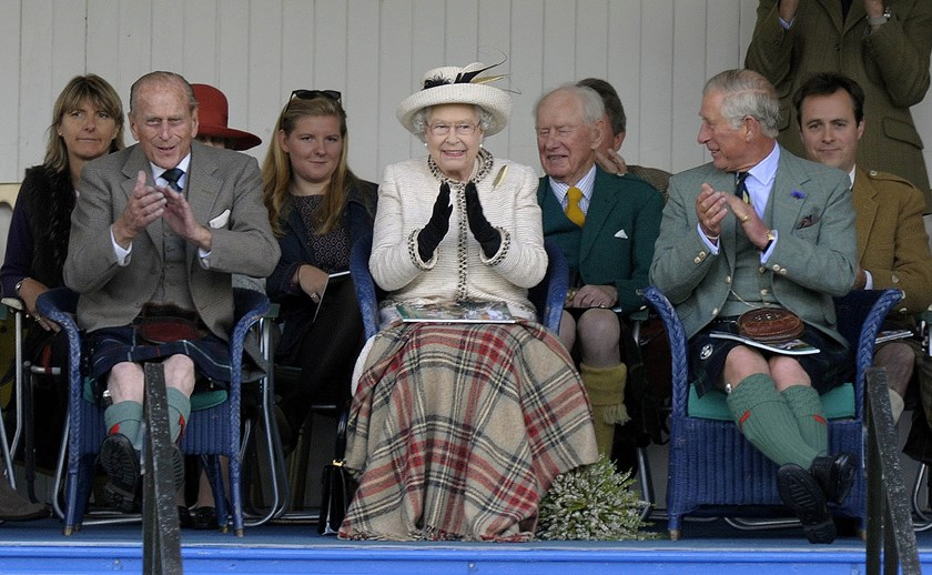 Queen Elizabeth II (C), her husband Prince Philip (2nd L) and eldest son Prince Charles, (3rd R) attend the Braemar Gathering in Braemar, central Scotland, on September 6, 2014.  Photo: AFP