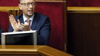 Ukraine's Prime Minister Arseny Yatseniuk reacts during a session of the parliament in Kiev August 14, 2014. Photo credit: Reuters