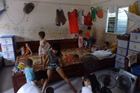 This picture taken on May 28, 2013 shows young children playing inside a dormitory room at the Hanoi-based Bo De Pagoda orphanage, which was hit by a child-trafficking scandal in August. Photo credit: AFP