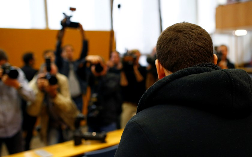 Defendant Kreshnik B., waits for the start of his trial in a courtroom in Frankfurt September 15, 2014. Kreshnik B, 22, is accused of being a member of the Islamic State, and is believed to have travelled to Syria in July 2013 with the intention of fighti