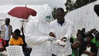 A volunteer health worker practises using a personal protective equipment (PPE) suit at a newly-constructed Ebola virus treatment centre in Monrovia, Liberia, September 21, 2014.  Photo credit: Reuters