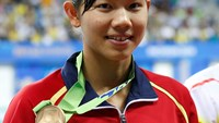 Bronze medalist Nguyen Thi Anh Vien of Vietnam poses on the podium at the women's 400m individual medley final award ceremony at the Munhak Park Tae-hwan Aquatics Center during the 17th Asian Games in Incheon September 23, 2014. Photo credit: Reuters