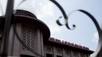 The State Bank of Vietnam, shot through a gate, stands in Hanoi, Vietnam, on Saturday, May 30, 2014.  Photo credit: Bloomberg