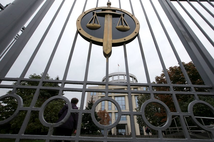 A city court building is seen through its gate in Moscow, September 24, 2014. Photo credit: Reuters