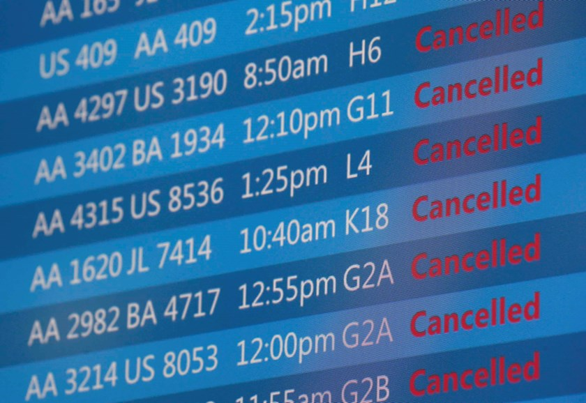 An American Airlines flight board displays cancelled flights at O'Hare International Airport in Chicago, Illinois, September 26, 2014. Photo credit: Reuters