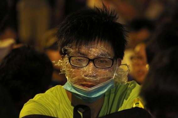 A protester wearing rudimentary protection against pepper spray is pictured during a confrontation with the police, after a rally for the October 1 'Occupy Central' civil disobedience movement in Hong Kong September 27, 2014. Photo credit: Reuters