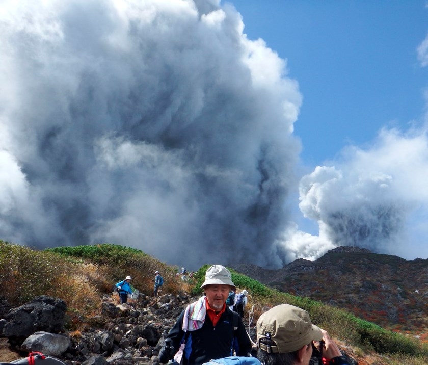 Climbers descend Mt. Ontake, which straddles Nagano and Gifu prefectures, to evacuate as the volcano erupts in central Japan September 27, 2014, in this photo taken by a climber and released by Kyodo. Photo credit: Reuters