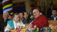 Tibetan spiritual leader His Holiness the Dalai Lama (R) shares a light moment with Nobel Peace Prize laureate Jody Williams during a commemoration event marking 25 years since the Nobel Peace Prize was awarded to the Dalai Lama at Tsuglakhang temple in M