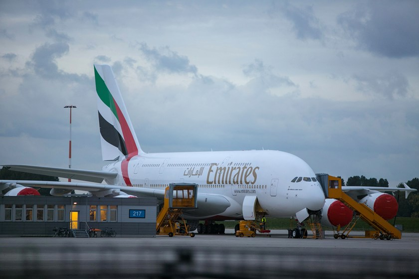 An Airbus A380-800 aircraft displaying Emirates airline livery stands at the Airbus Group NV plant in Hamburg, Germany, on Sept. 25, 2014.  Photo credit: Bloomberg