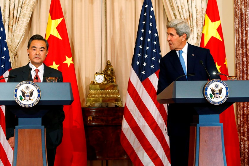 U.S. Secretary of State John Kerry (R) delivers remarks as China's Foreign Minister Wang Yi (L) looks on, before their meeting at the State Department in Washington October 1, 2014. Photo credit: Reuters