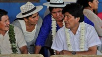 Bolivia's President Evo Morales (R) talks with coca growers in Villa 14 de Septiembre, in the Chapare region in Cochabamba October 12, 2014. Photo credit: Reuters