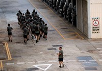 Members of the People's Liberation Army (PLA) exercise at a PLA base next to government headquarters in Hong Kong October 8, 2014. Photo credit: Reuters