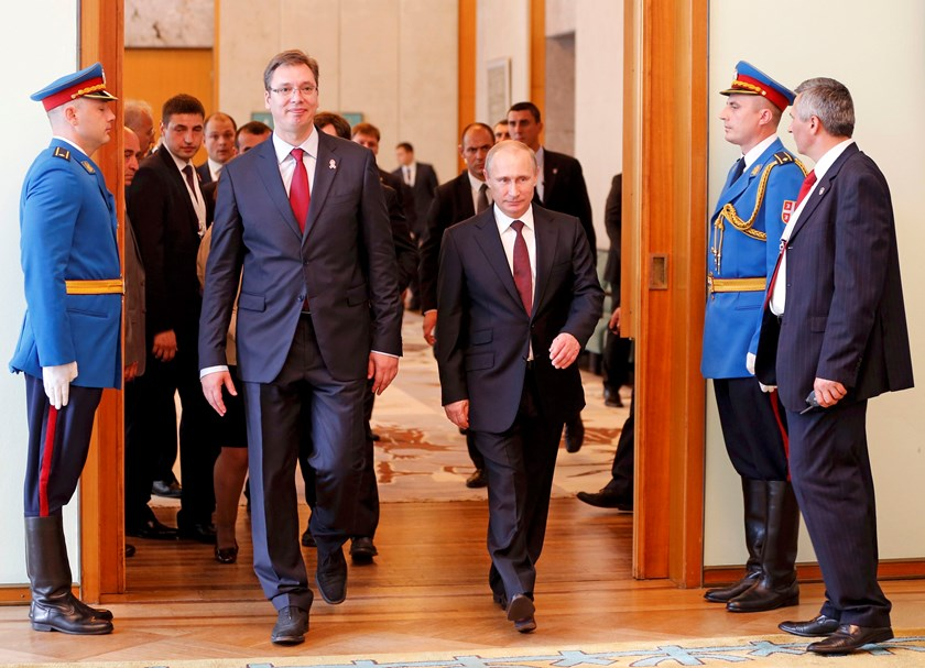 Russian President Vladimir Putin is welcomed by Serbian Prime Minister Aleksandar Vucic (R) at the government headquarters in Belgrade October 16, 2014. Photo credit: Reuters