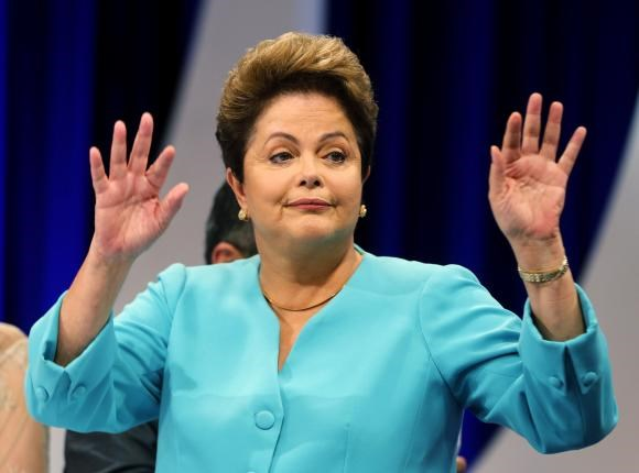 Brazil's presidential candidate Dilma Rousseff of Workers Party (PT) gestures during a debate in a television studio in Sao Paulo October 16, 2014. Photo credit: Reuters