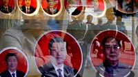 Paramilitary policemen and pedestrians are reflected on the shop window of a shop selling souvenirs bearing the pictures of China's President Xi Jinping (L) and former leaders near the Great Hall of the People in Beijing October 23, 2014. Photo credit: Re